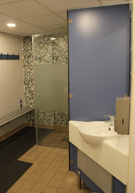 The ladies' changing room, with shower, sink, toilet and changing bench